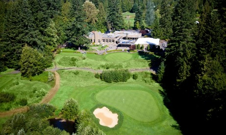 Aerial view highlights Mt. Hood Oregon Resorts Mallards Cafe & Pub, Golf Pro Shop and the first fairway of The Courses 27 holes in Mt. Hood Territory