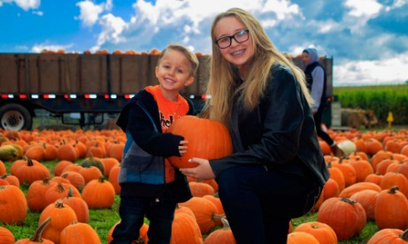 Brother and sister show off their pumpkins picked in Mt. Hood Territory