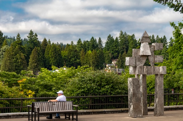 Man on a bench at Millennium Plaza park in Lake Oswego