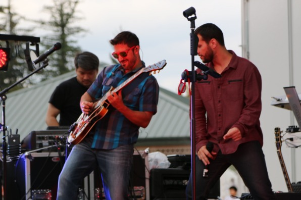 Guitarist, singer and keyboardist on stage at Happy Valley's Concerts in the Valley