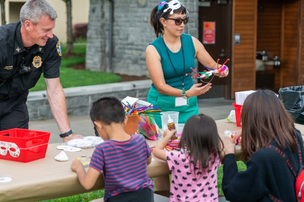 Art activity table with children making art at Lake Oswego