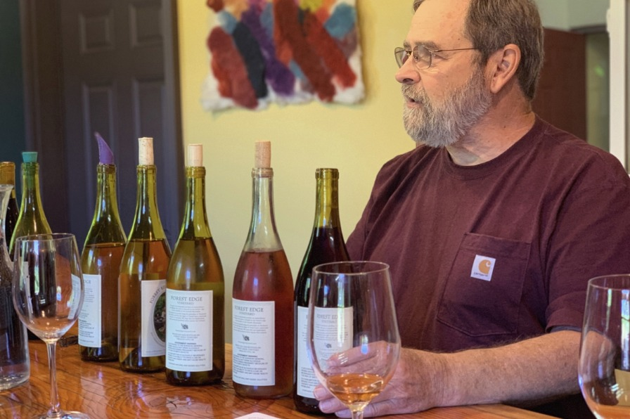 Winemaker pours wine at Forest Edge Vineyards