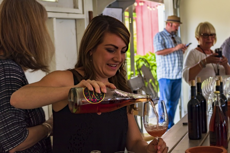 Woman pours wine for tasting at Terra Vina Vineyards