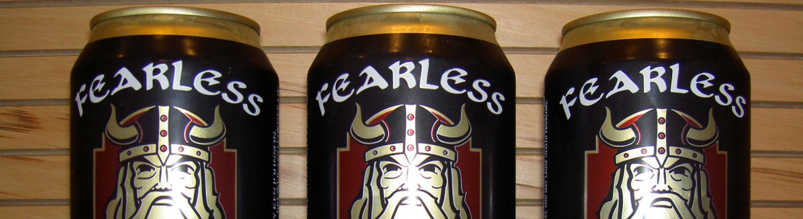 Fearless Brewing distributes its Scottish Ale in tall black cans lined up face forward.