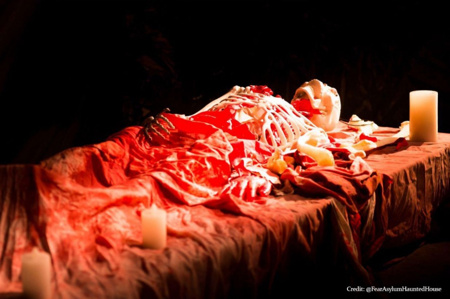 staged skeleton covered in blood at milwaukie haunted house event