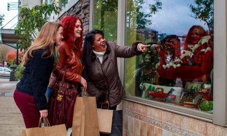 three females window shopping and walking on the street of Lake Oswego in Mt. Hood Territory