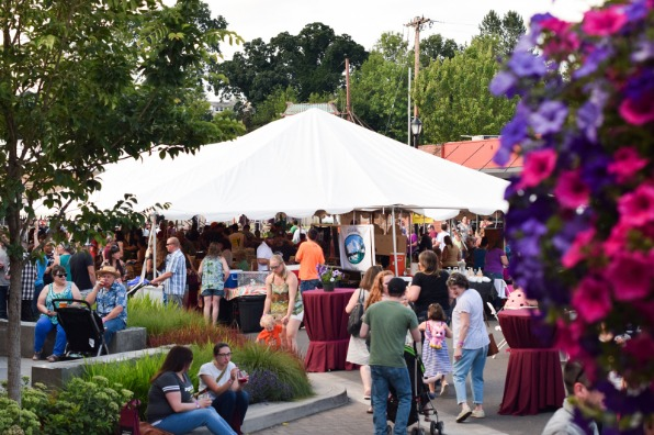 Estacada Uncorked with flower baskets