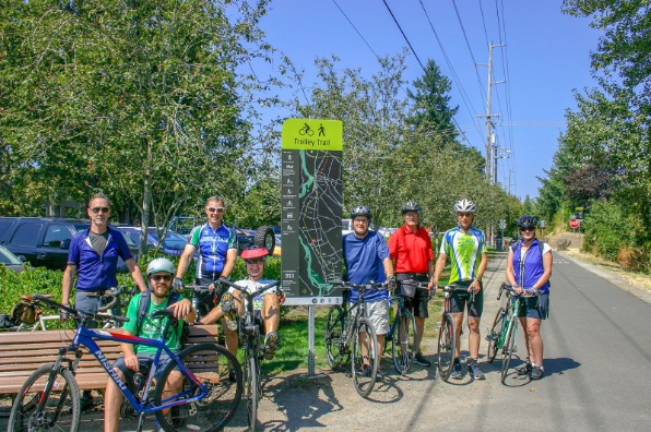 Bike/Ped Committee cycling the new Trolley Trail parked in front of the map sign