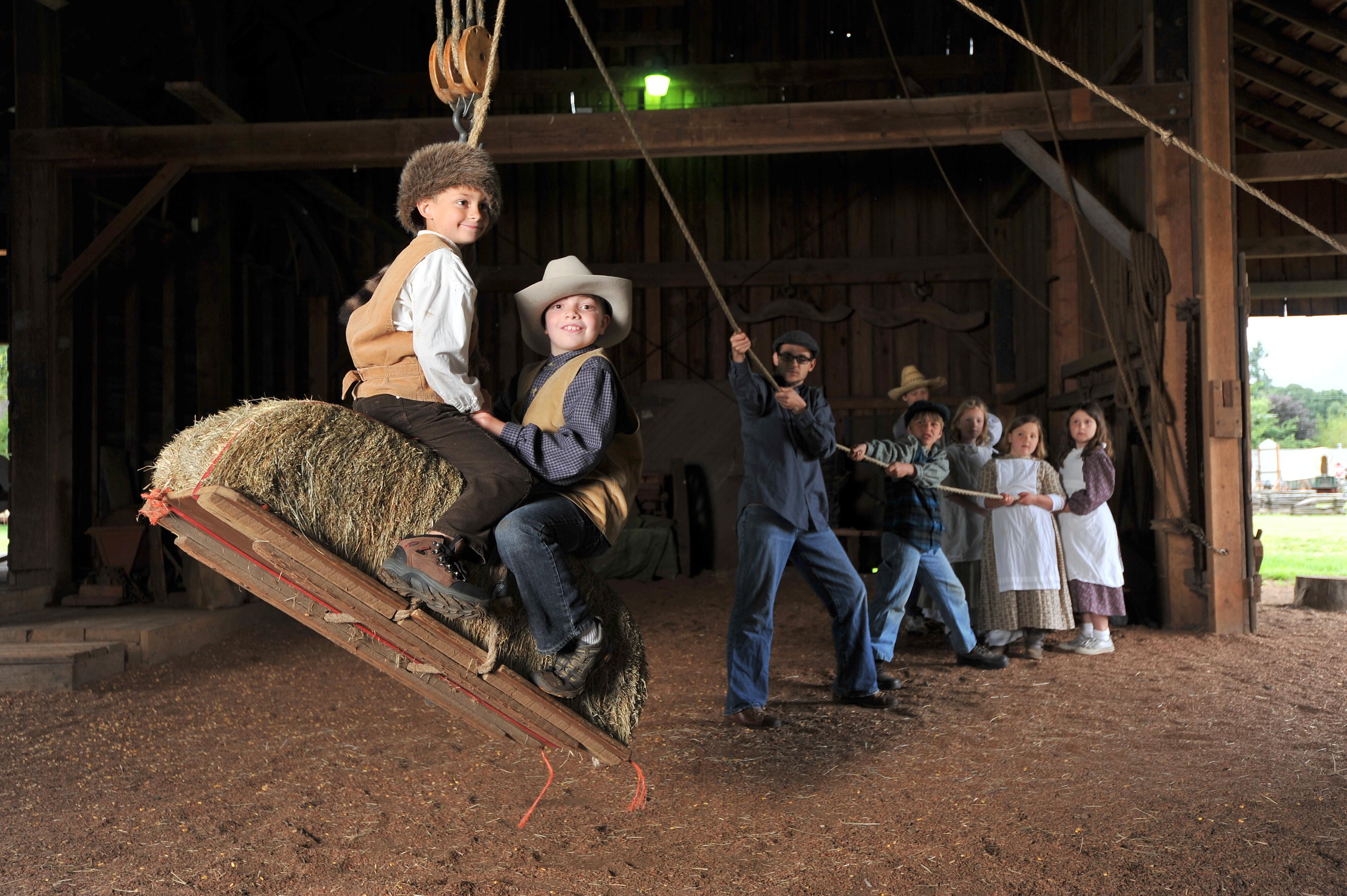 Philip Foster Farm Boys on Hay Bale Swing