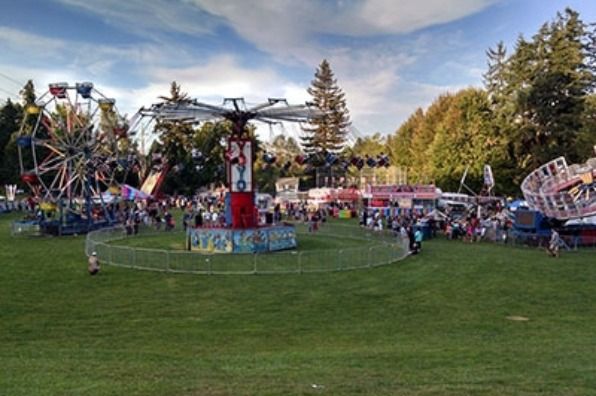 Attendees at West Linn's Old Time Fair enjoy carnival rides and game and food booths