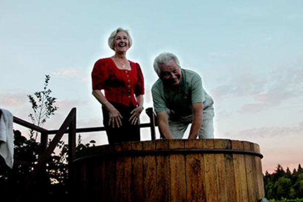 St. Josef's Winery winemakers standing in an oversized barrel stomping grapes at the annual festival