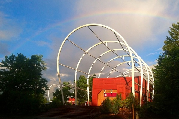 End of the Oregon Trail Interpretive Center exterior with rainbow going over the covered wagon frame