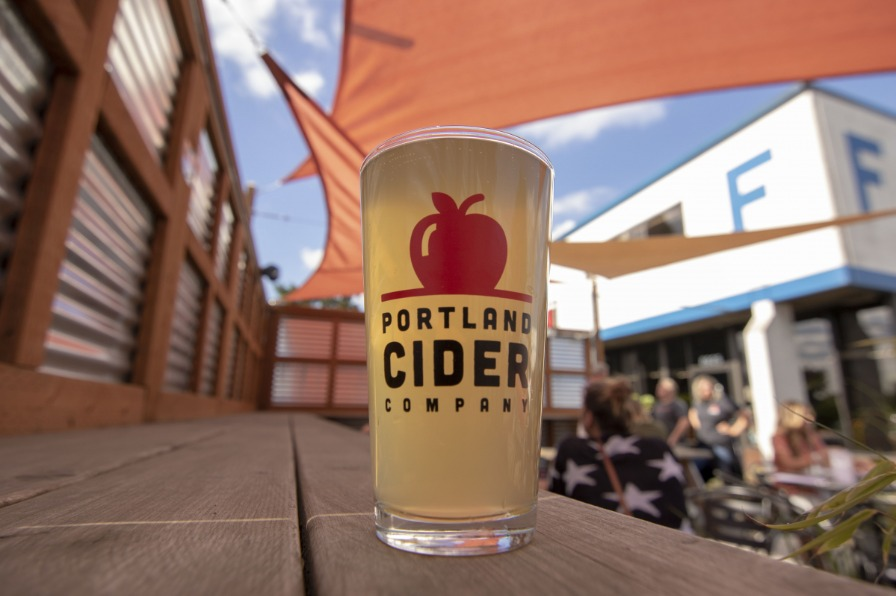Glass of cider on a counter outside at Portland Cider Company