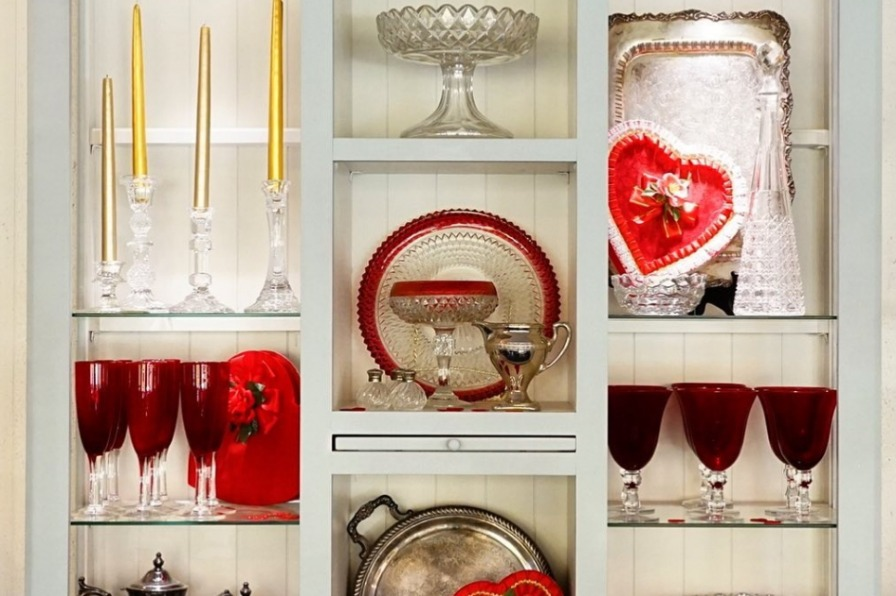 candles, dishes and heart shaped platters on a shelf at Crafters and Curators Market