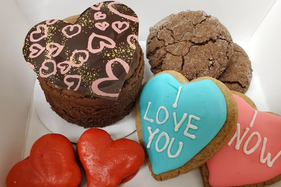 cheesecake, heart shaped cookies and heart shaped macaroons in a box from Baker's Prairie Bakery