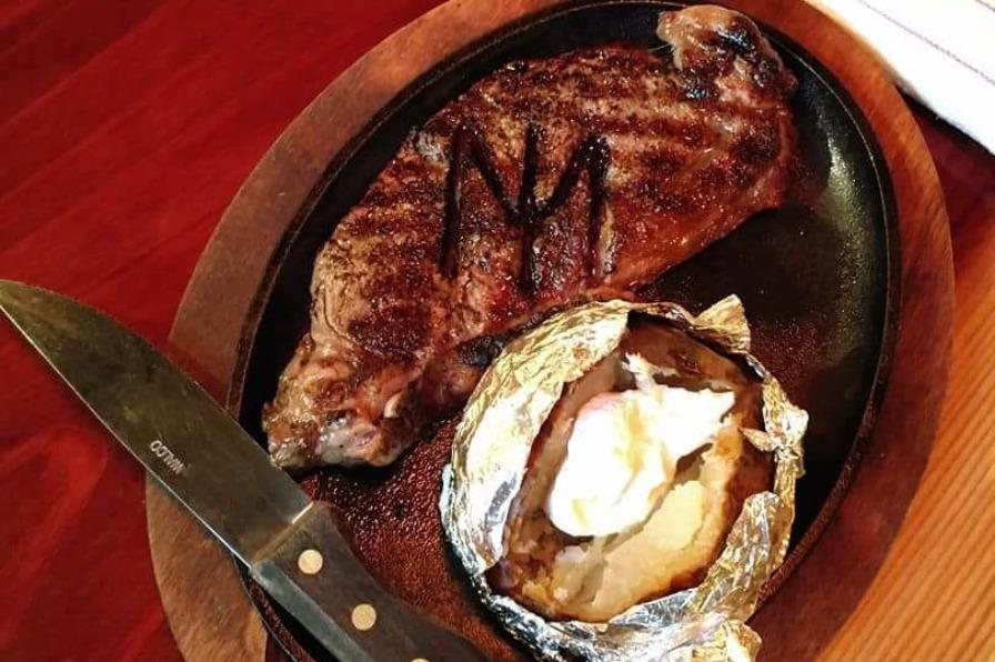 Steak and baked potato from Markum Inn in Molalla