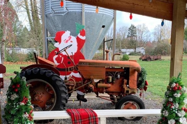 Cutout of Santa riding a vintage tractor at Wade Creek Vintage Marketplace