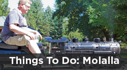 Man riding model train for things to do in Molalla related articles link image