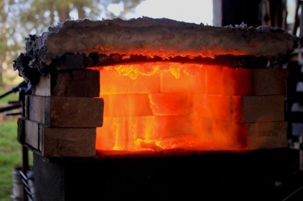 Closeup of the blazing flames inside the brick forge at Red Pig Garden Tool blacksmith shop in Boring Oregon