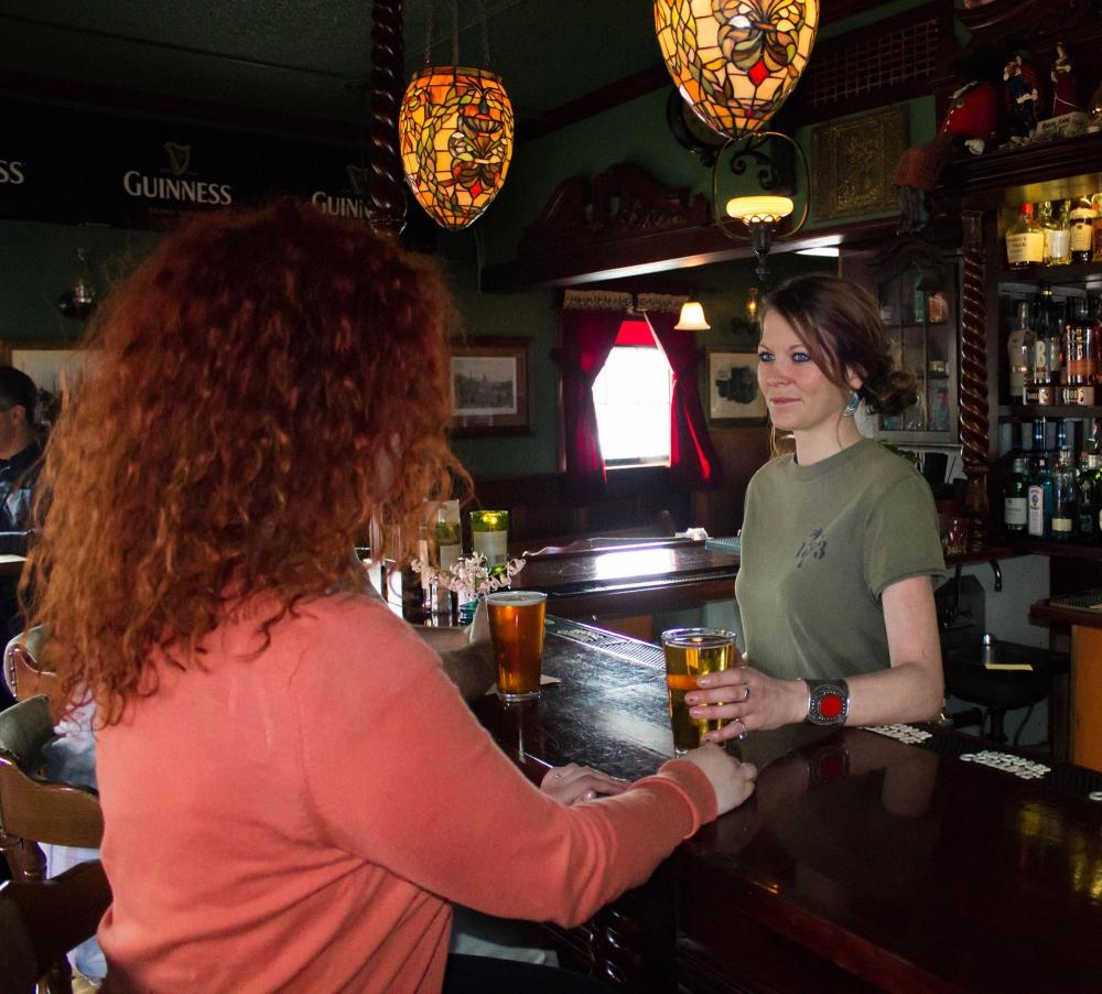 Highland Stillhouse bartender serving beer to guest in Oregon City in Oregons Mt. Hood Territory.