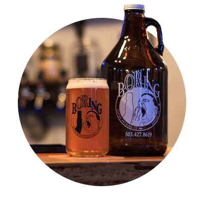 Boring Brewing growler and a glass of beer with logo depicting a bored, yawning man