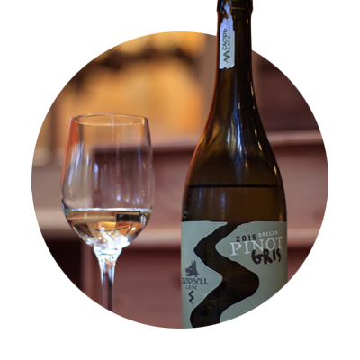 Circular photo of glass of wine and bottle of Pinot Gris from Campbell Lane Winery on Pete's Mountain in West Linn