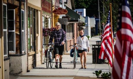 Couple Walking Bikes