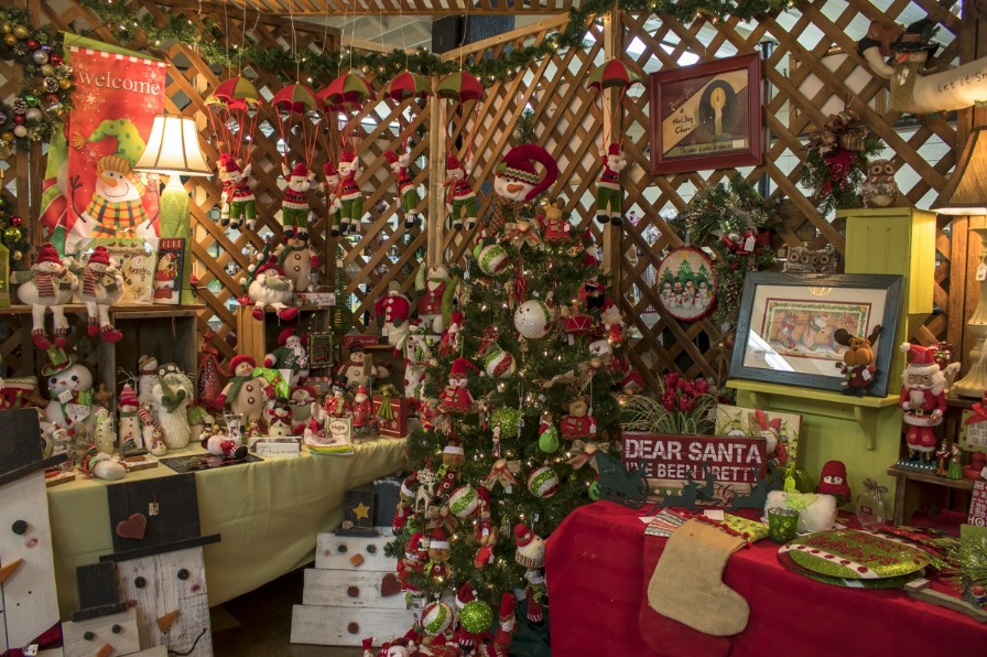 One-of-a-kind snowmen and parachuting Santas are front and center for purchase from this vendor booth at the holiday bazaar