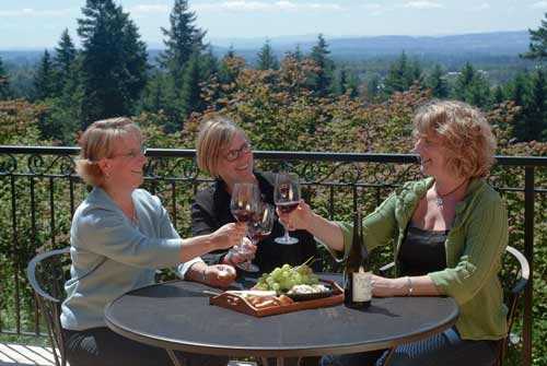 women wine tasting at Christopher Bridge Cellars in oregons mount hood territory