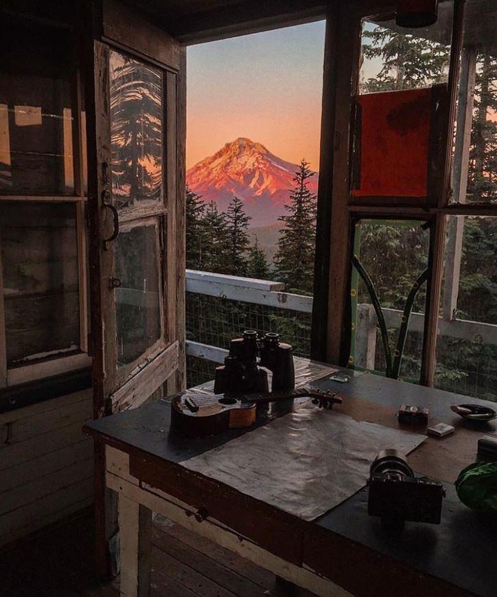 mt hood sunrise view from window inside a fire lookout