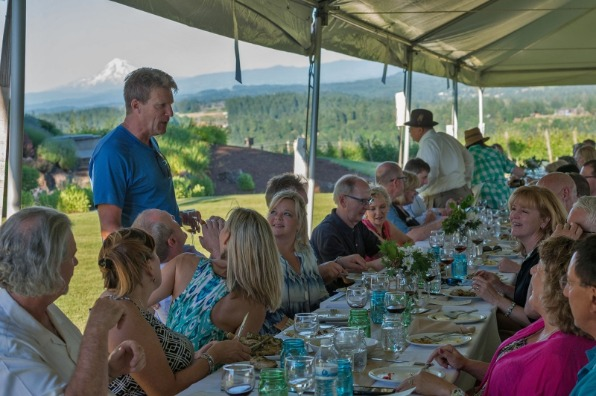 Large group enjoy their entrées and wine at a Dinner in the Field as Pete's Mountain Winery vintner talks about his wines