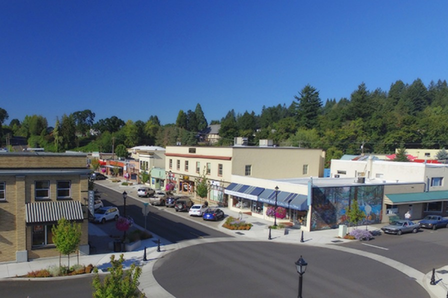 Aerial view of newly completed streetscape of Broadway Street, mural on side of buliding, and downtown Estacada businesses
