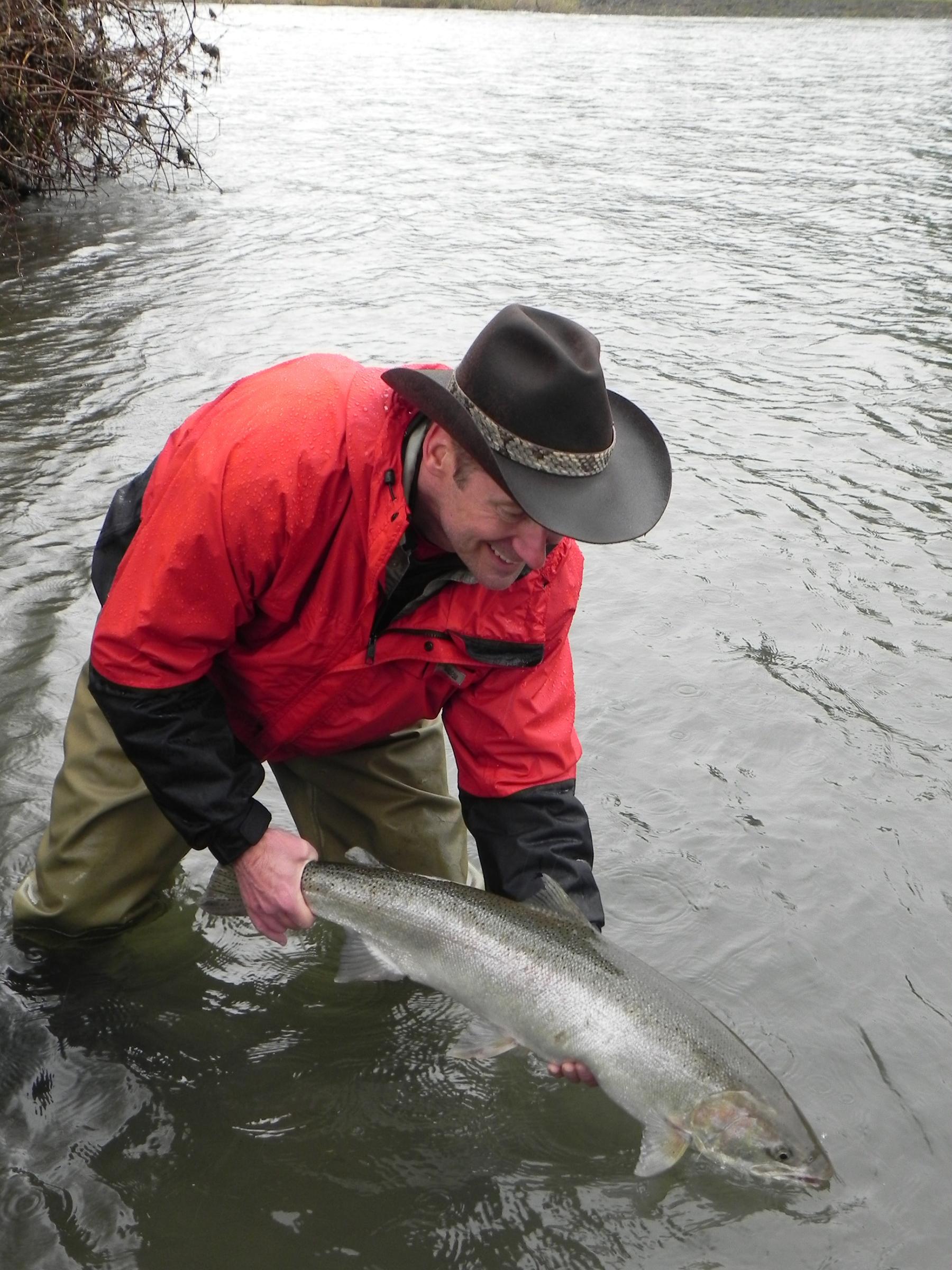 Wild steelhead must be released. Gary Lewis caught this Clackamas River steelhead on a cerise jig beneath a float. Photo by Jennifer Lewis.