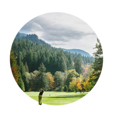 A golfer hits one of his woods down a fairway dotted with autumn colors at The Courses at the Mt. Hood Oregon Resort.