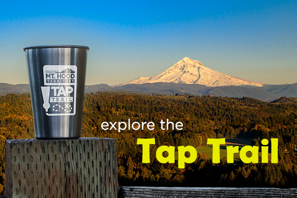 Oregon's Mt. Hood Territory stainless steel Tap Trail tumbler sits atop fence post at Jonsrud Viewpoint with Mt. Hood in view