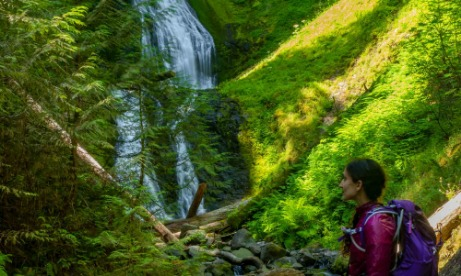 Woman in front of Pup Creek Falls Clackamas River Trail Mt. Hood National Forest