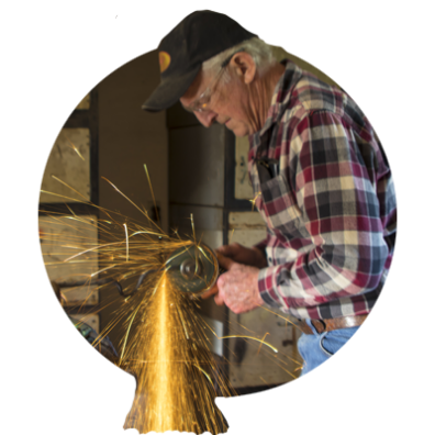 With sparks flying, Bob Denman grinds a new garden tool at Red Pig Tools in Boring, Oregon, in Oregon's Mt. Hood Territory.
