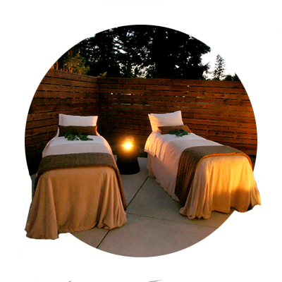 Two massage beds await a couple for a relaxing outdoor evening massage at The Spa at Mt. Hood Oregon Resort in Welches