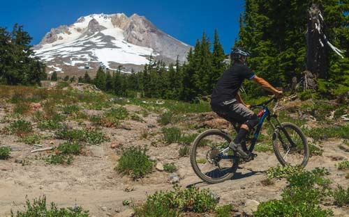 Mountain biking in front of Mt. Hood at Timberline Lodge