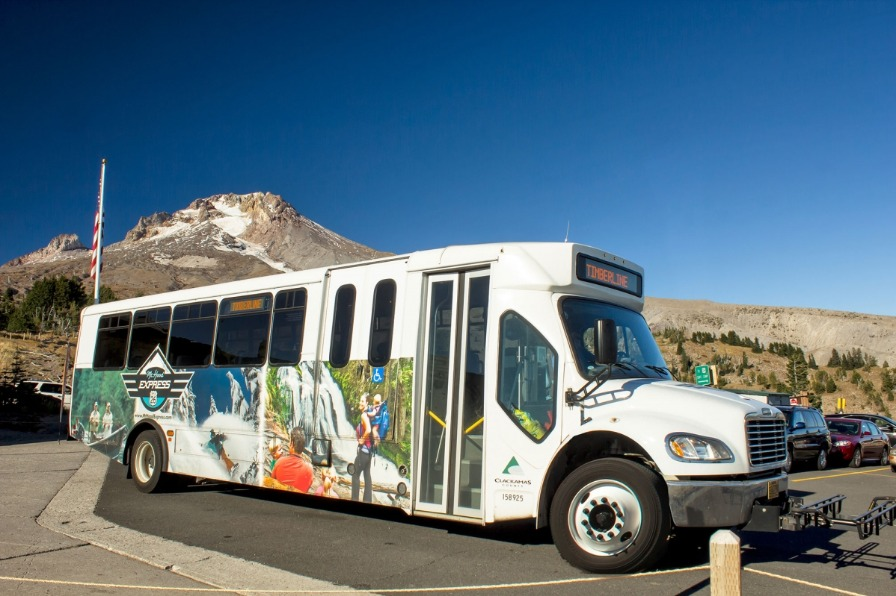 Mt. Hood Express bus in the Timberline Lodge parking lot upon arriving from Sandy with designated stops along the way