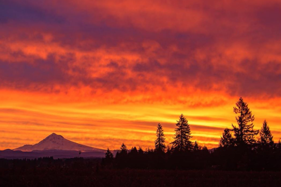 orange and yellow sky sunrise with mt hood in the distance in boring, oregon