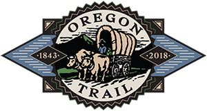 Oregon Trail 1843-2018 blue & black logo depicting pioneer in covered wagon pulled by team of oxen with mountain background
