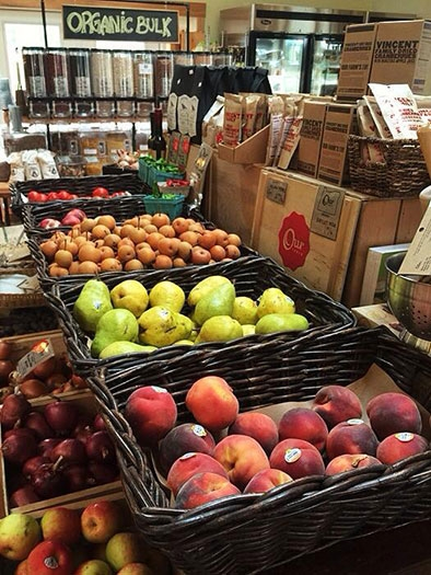Baskets filled with local peaches, pears, plums and apples are displayed at Our table Cooperative farm store in Sherwood