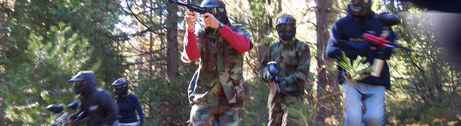 Five paintballers armed with paintball guns go in search of the enermy at one of three paintball locations in The Territory.