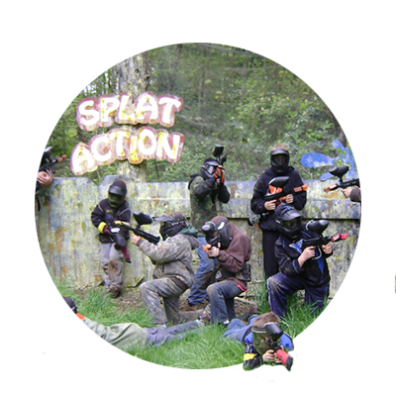 A team of 10 or 11 paintball enthusiasts in full protective gear fires away at enemy cobatants at Splat Action Painball.