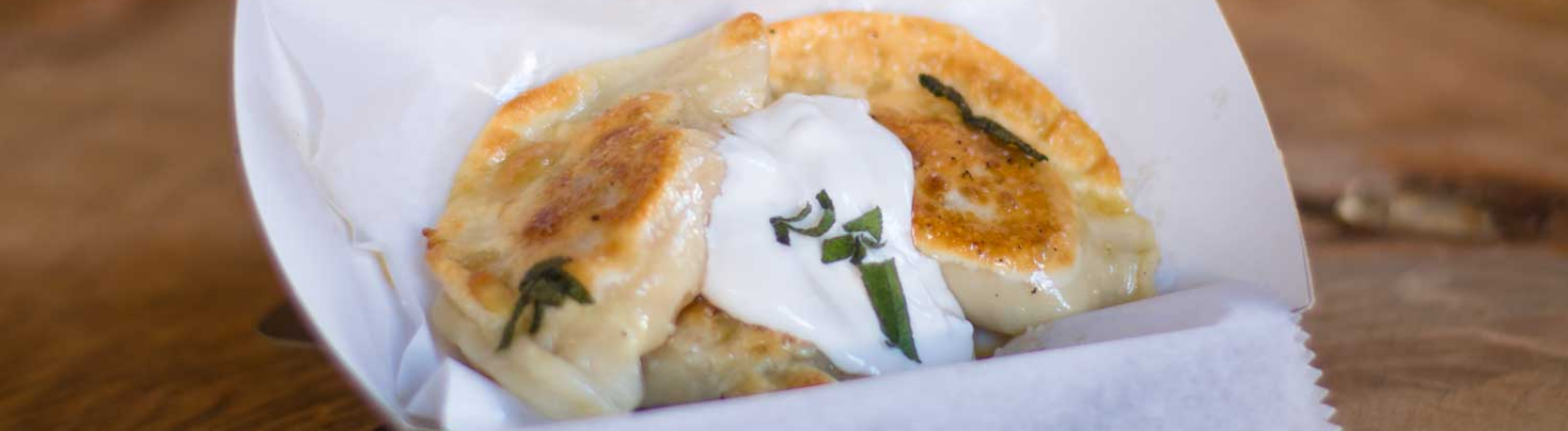 Pierogi with sour cream at The Perky Pantry food cart in Oregon City in Oregon's Mt. Hood Territory