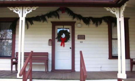 During the holiday season, fresh garlands and wreath adorn front door and porch of historic Philip Foster Farm in Eagle Creek