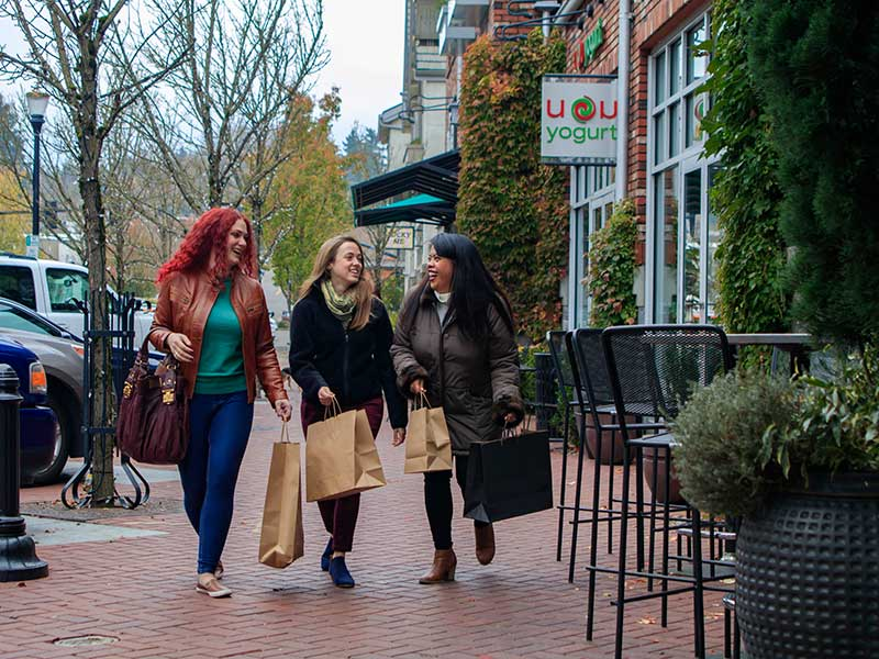 three females shopping and walking on the street of Lake Oswego in Mt. Hood Territory