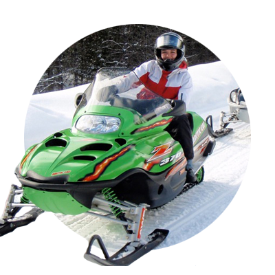 Young female riding a bright green snowmobile in Oregon's Mt. Hood Territory
