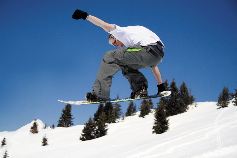 snowboarder jumping at Timberline Lodge and ski area mount hood